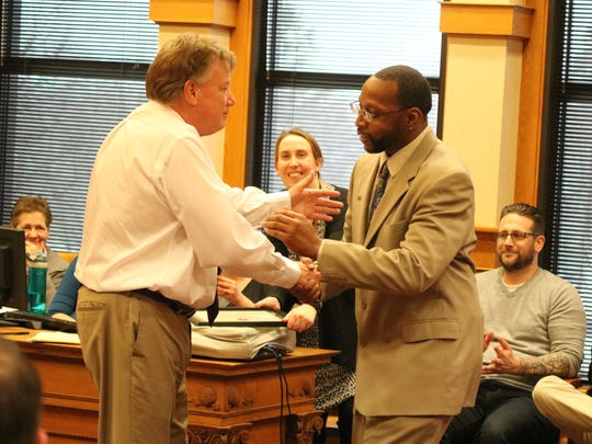 Ottawa County Common Pleas Court Judge Bruce Winters offers a handshake and a hug to Drug Court graduate Damion Tall.