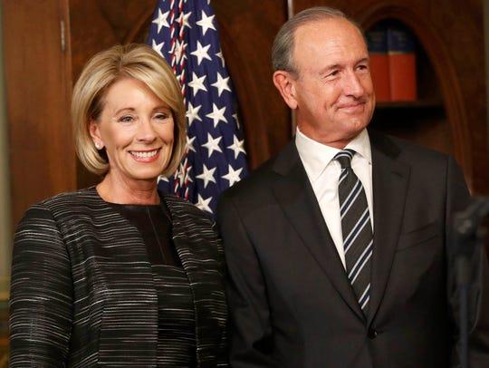 Betsy DeVos waits to be sworn in as Education Secretary