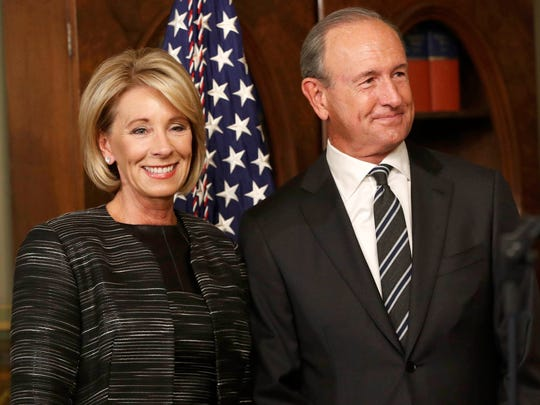 Betsy DeVos waits to be sworn in as Education Secretary