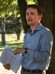J.D. Klippenstein, Executive Director at ACTIONN, speaks during a potluck/prayer vigil at the Unitarian Universalist Fellowship of Northern Nevada on June 28, 2017.