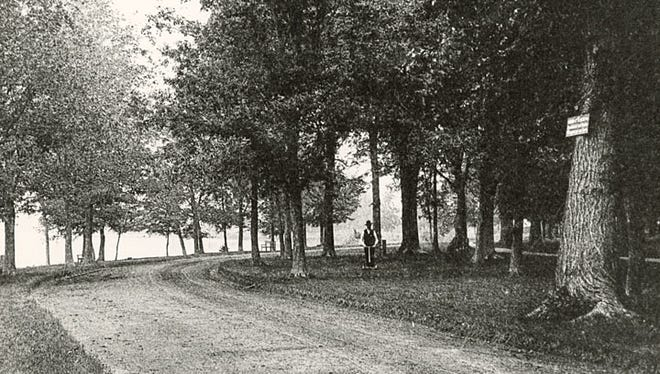 A man cuts grass at Riverside Park in Neenah in this photograph, circa 1887. The tract of land which is now Riverside Park was owned by lumberman Henry Sherry. Early in 1872 Sherry offered to sell to the village of Neenah 15 to 20 acres for a public park. The purchase was approved by Neenah's voters on Dec. 24, 1872.