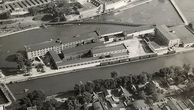Menasha Wooden Ware is shown in this 1947 aerial view. The street at the bottom right is Main Street, and the Menasha Library, in its Mill Street location, can be seen in the lower left corner.