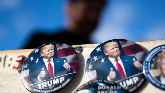 Buttons for sale are posted as preparations continue for Friday's inauguration of Donald Trump in Washington, Wednesday, Jan. 18, 2017.