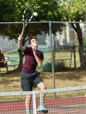 Father Duenas player Tyler Talai hits the high forehand volley during his 2016 Independent Interscholastic Athletic Association of Guam Tennis League doubles match at the Tamuning tennis courts on Feb. 18, 2016.
