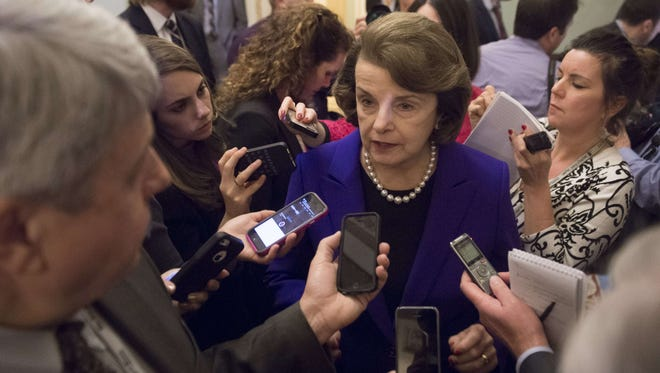 Senate Intelligence Chairwoman Dianne Feinstein, D-Calif., speaks to reporters about the committee's report on CIA interrogations on Dec. 9, 2014.