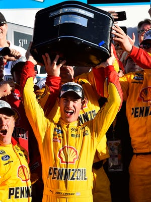 Joey Logano celebrates with Harley J. Earl Trophy after winning the 2015 Daytona 500.