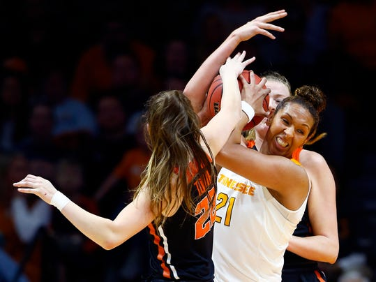 Tennessee center Mercedes Russell (21) is pressured by Oregon State's Kat Tudor (22) and Marie Gulich during the first half of a second-round game in the NCAA women's college basketball tournament Sunday, March 18, 2018, in Knoxville, Tenn. (AP Photo/Wade Payne)