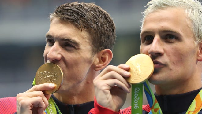 Michael Phelps, left, and Ryan Lochte, who lived in Bristol, celebrate winning the gold medal in the men's 4x200-meter freestyle relay Tuesday in Rio de Janeiro.