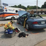 A firefighter investigates a car crash at Kearney and Melville on Tuesday.