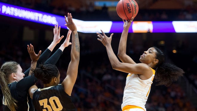Tennessee's Diamond DeShields attempts to score while defended by Vanderbilt's Erin Whalen, left, and LeaLea Carter at Thompson-Boling Arena on Sunday, January 22, 2017.