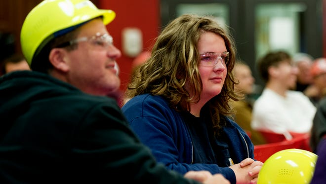 Jake Clark (second from left), a 16-year-old cancer survivor, attends a team meeting at the Clayton Homes manufacturing plant in Bean Station, Tennessee, on Wednesday, November 22, 2017. Jake aspires to have a career in computer animation and spent time with the engineering department creating a blueprint of a house and learning how the homes are built.