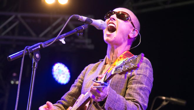 Sinead O'Conner performs at Day 2 of Bestival on Sept. 6, 2013. Her facial tattoo is hard to see in this photo.