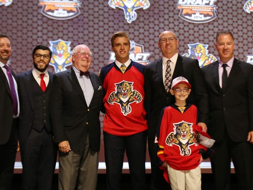 The status of the NHL's 2014 first-round draft picks: 1. Florida Panthers: Aaron Ekblad, D, Barrie Colts (OHL). He suffered a concussion in early August and signed a three-year, entry-level deal on Sept. 3.