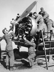 Mechanics work on aircraft at Williams Field during