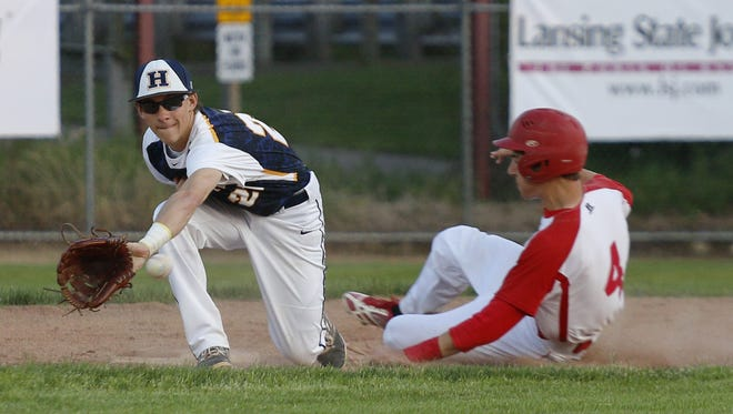 Hayden Cross, left, and Haslett are ranked No. 9 in the Division 2 state baseball poll this week.