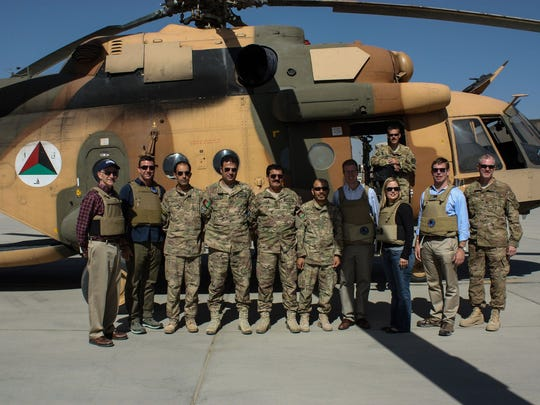 During a three-day tour of Afghanistan in 2013, U.S. Rep. Kyrsten Sinema (third from the right), stands with fellow lawmakers and military staff in front of a Russian-built Mi-17 helicopter used by the Afghan army.