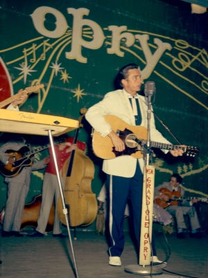 Johnny Cash color photo on the Ryman stage – rare color photo of Johnny Cash performing on the Opry in a suit his mother made him. This would have been taken in the late 1950s.  Submitted by the Country Music Hall of Fame