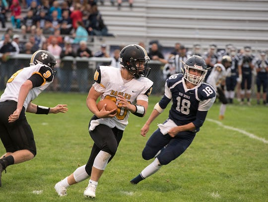 Trevor Shawber rushes the ball against Carey.