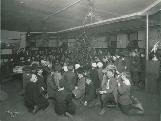 Children gather for a Christmas program in the basement