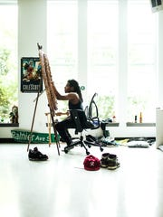 An artist works in one of the live/work spaces designed by Artspace in Seattle.