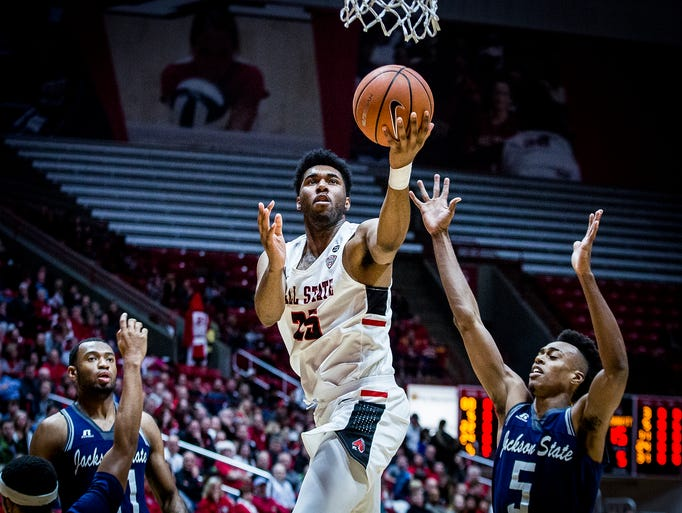 Ball State's Tahjai Teague shoots past Jackson State's