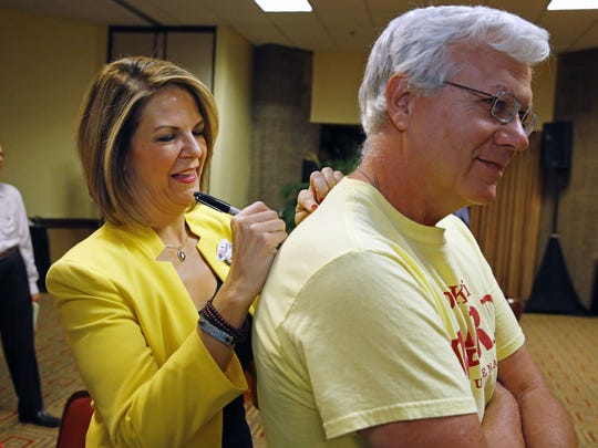 Kelli Ward, Republican candidate for U.S. Senate, signs