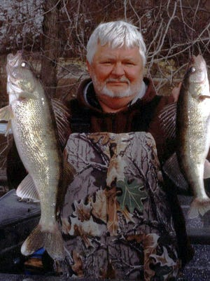Bob Zownir with two nice walleyes caught wading during the cold water period