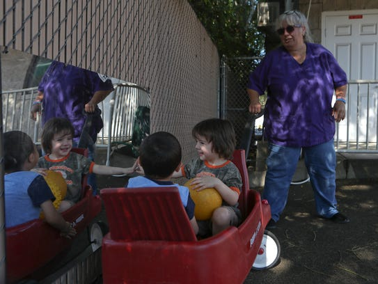Izac Pena, from left, and Robert Lee, both 3, are pulled
