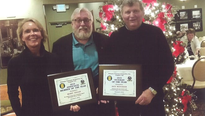 The Vietnam Veterans of Manitowoc County Chapter 731 recently named Mary Tegen, left, Associate Member of the Year and Ken Wentker, right, Veteran Member of the Year. Also pictured is Vietnam Veterans of Manitowoc County Chapter 731 vice-president Dale Schroeder.