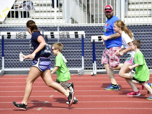 Runners compete Wednesday, May 6, 2015 during Franklin County Special Olympics at Trojan Stadium. Markell DeLoatch - Public Opinion