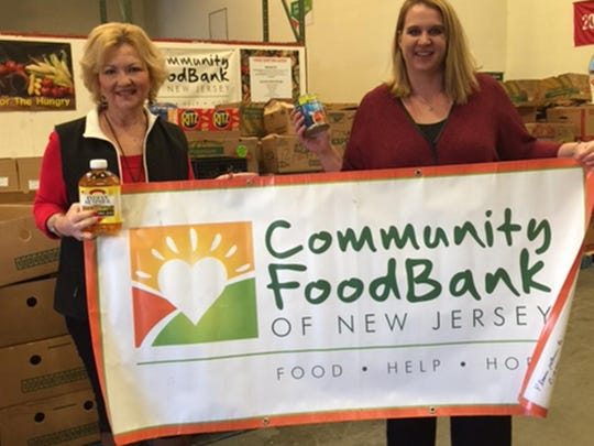 Atlantic Christian Upper School Principal Susan Smith (right) delivers more than 350 pounds of canned soup and other nonperishable food collected at the Bowls of Hope event to Colette Kraus (left) at the Community FoodBank of NJ, Southern Branch, on Feb. 6.