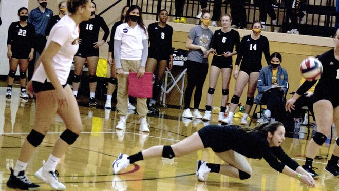 Ottawa University junior Ava Taton dives to dig the ball during Wednesday's sweep of Bethany at Wilson Field House.