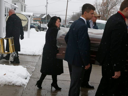Funeral Director Jennifer Sullivan of Thomas J. Shea Funeral Home, Inc., in Binghamton, during a funeral service on Tuesday, January 16, 2018.