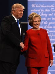 Democratic nominee Hillary Clinton  shakes hands with Republican nominee Donald Trump at the start of the first presidential debate at Hofstra University in Hempstead, N.Y.  on Sept. 26, 2016.