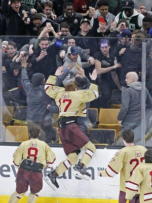 BC High hockey players celebrate after beating Pope Francis in the fourth overtime period of the Super 8 final at the TD Garden on Sunday, March 17, 2019. (Greg Derr/The Patriot Ledger)