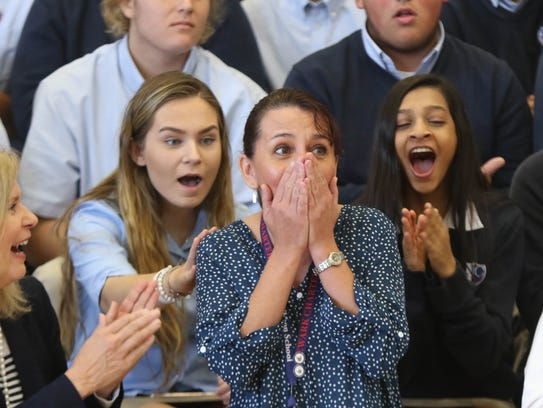 Tami Lunsford, an AP biology and marine science teacher at Newark Charter School, is overwhelmed at an assembly at which it was announced she was receiving the $25,000 Milken Educator Award. Educators can't apply for the Milken award, and do not know they are under consideration.