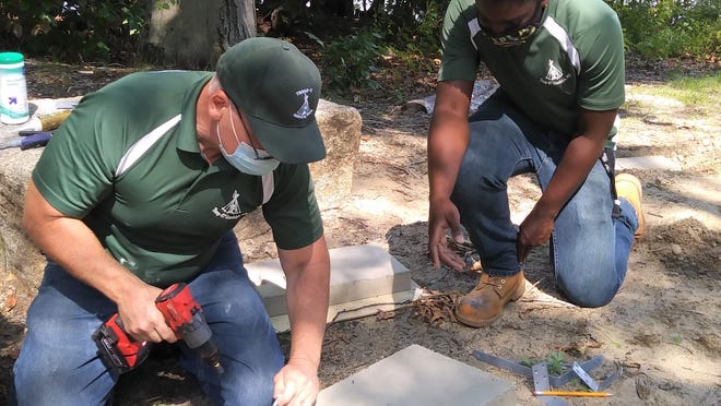 Scout Troopmaster Henry Colageo Sr. (left) works with Boy Scout Ryan Robertson to construct benches at Powers Farm in Randolph for the Eagle Scout project.