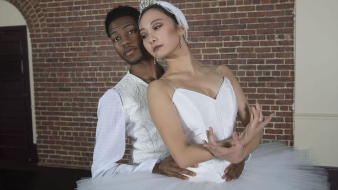 """Allen Waddell as Prince Sigfried and Ya Meng Lin as the White Swan star in Ballet Pensacola's production of """"Swan Lake."""""""