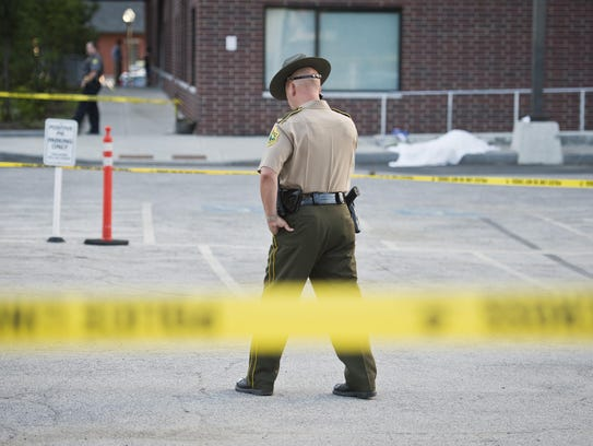 Vermont State police guard the scene of a fatal shooting