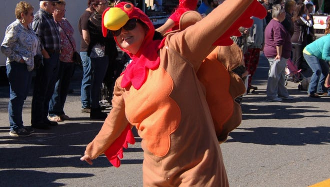 A life-sized turkey soars into action during Turkey Trot festivities at the 2016 Mid-Marion County Rotary Club parade through downtown Yellville. After being a longtime sponsor of the festival's parade, the Rotary Club will serve as the event's primary sponsor when the festival returns this weekend.