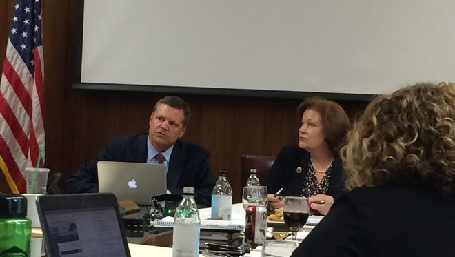 Keith Lamb, vice president of student affairs and enrollment management, and Marilyn Fowle, vice president of administration and finance, tell MSU's board of regents at a May 11 meeting about the creation of a new fee, an international recruitment fee, to be charged to international students.