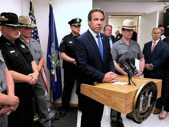 Gov. Andrew Cuomo talks to reporters Monday about the