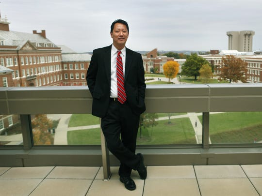 In this 2012 photo, Ono stands outside of his office at the University of Cincinnati.