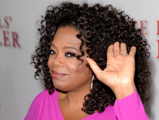 "Oprah Winfrey waves her left hand at the premiere of The Weinstein Company's ""Lee Daniels' The Butler"" at Regal Cinemas L.A. Live in 2013."
