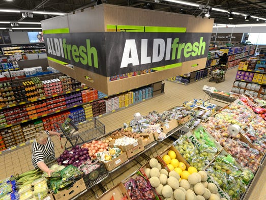 Customers shop at the Aldi grocery store at 6925 Durand