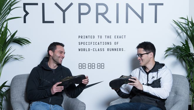 Roger Chen, right, senior director of advanced design and NXT innovation and Bret Schoolmeester, senior director for Nike's global running footwear, worked together on Nike's latest innovating project: the new Nike Flyprint, a 3D-printed performance shoe.