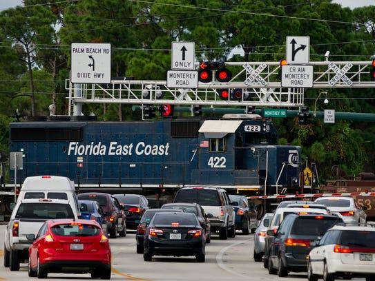 A Florida East Coast Railway train crosses Monterey
