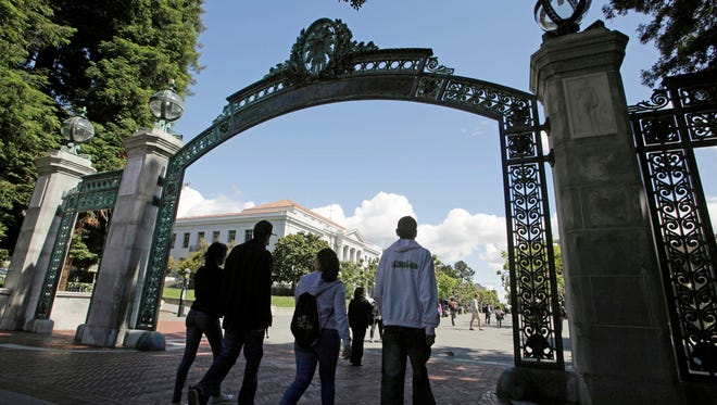 Students walk through the Sather Gate on the University of California, Berkeley campus in Berkeley, Calif.