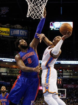 Thunder guard Russell Westbrook, right, shoots as Pistons center Andre Drummond defends during the first quarter of the Pistons' 103-87 loss Friday in Oklahoma City.