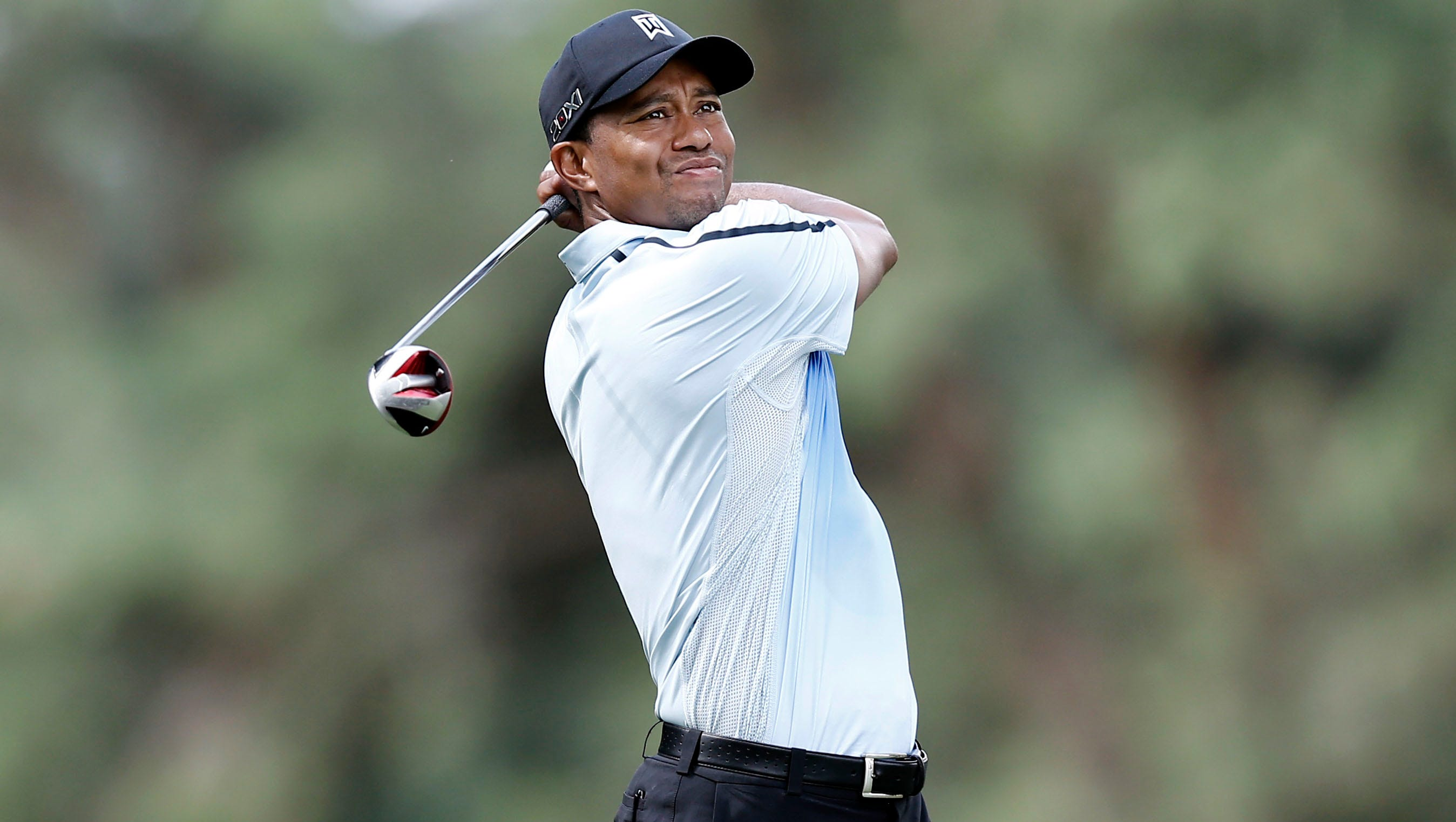 Tiger Woods tees off on the 18th hole.